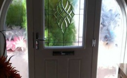 Feature door with decorative glass