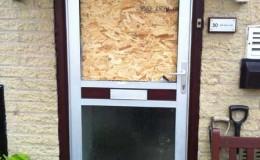 Aluminium door requiring replacement upper glass panel