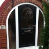 Curved feature door with twin sidelite windows