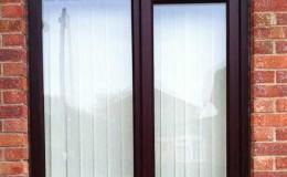 New install mahogany effect uPVC window