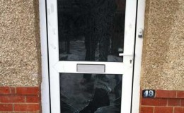uPVC door with smashed lower glass panel