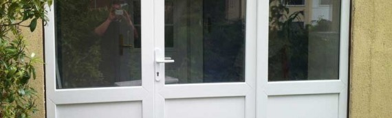 Renovated entrance with new uPVC door and twin side panels
